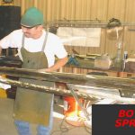 metalsmith working on bow sprit