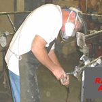 metalsmith working on radar arch